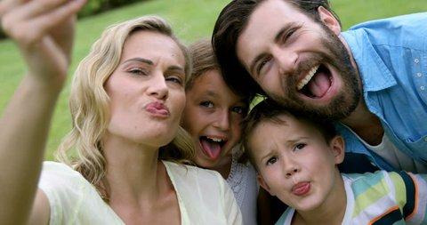 Happy family taking a selfie in the garden