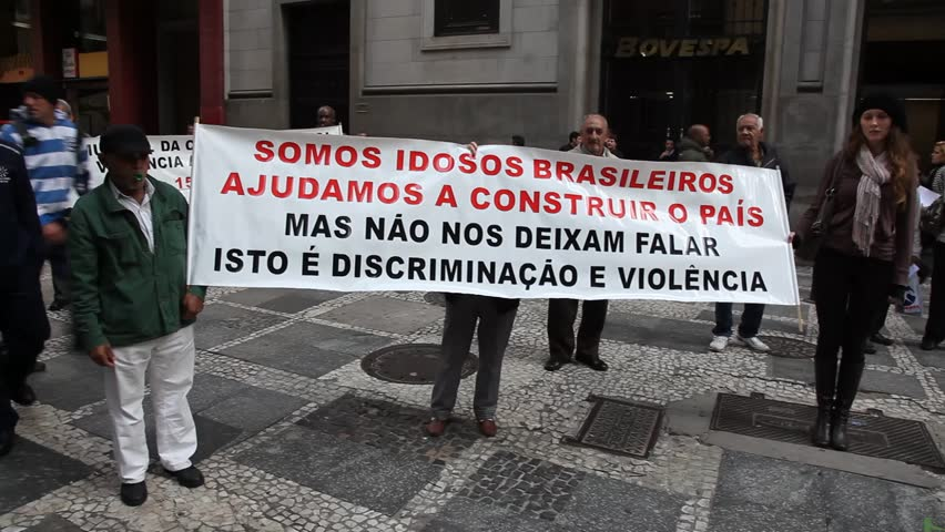 SAN PAULO, BRAZIL - CIRCA JUNE 2011: Demonstrators hold up banners protesting discrimination and violence against females and elderly circa June 2011 in San Paulo.