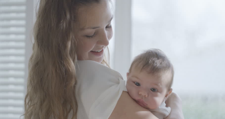 4K Portrait of new mother holding baby daughter at home, in soft natural light UK - April, 2016   Shutterstock HD Video #17023060