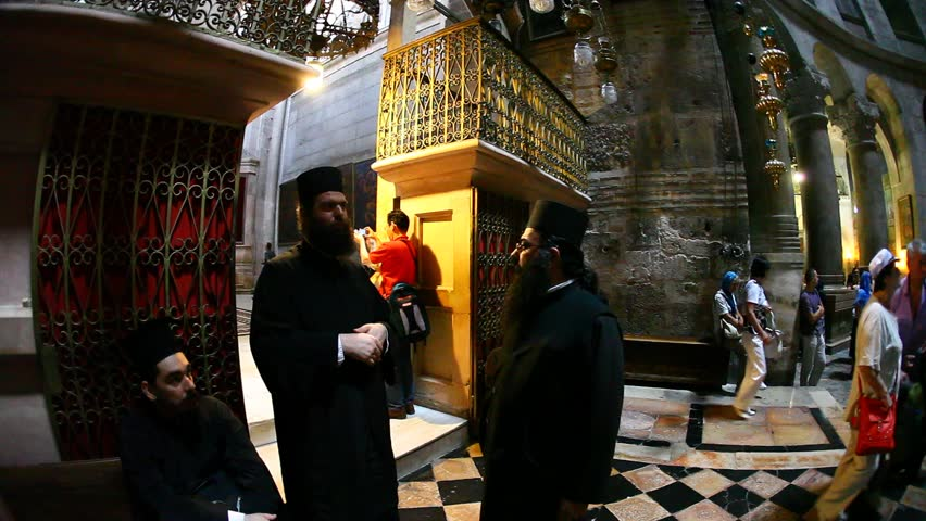 JERUSALEM, ISRAEL - CIRCA OCT 2011: Three priests have a conversation in the Church of the Holy Sepulchre circa October 2011 in Jerusalem.