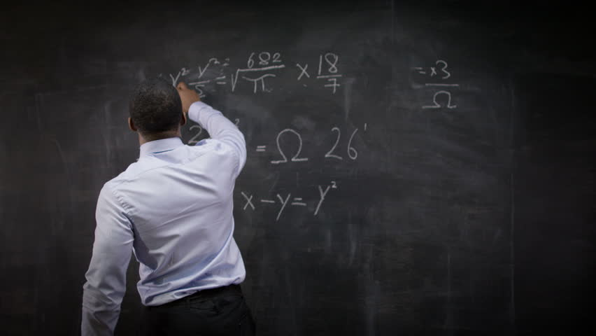 4K Young Smiling Teacher Writing Math Formulas On Blackboard Shot RED Epic UK