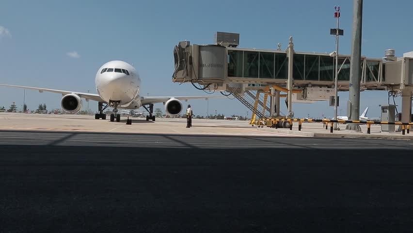 airplane aircraft plane - dock terminal gate - waiting - transportation - travel traveling - trip tour - commuter commuting background | Shutterstock HD Video #17105950