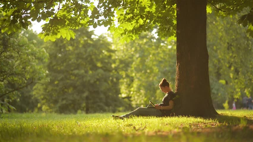 Young woman student using digital tablet for studying while sitting in the park, beautiful girl using tablet outdoors, beautiful garden, technology | Shutterstock HD Video #17126209