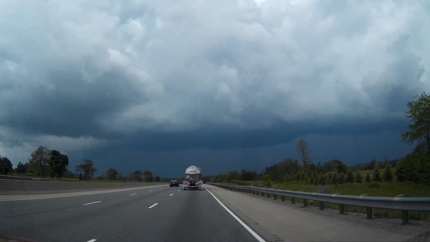 Waterloo, Ontario, Canada June 2016 POV dashcam driving stormchasing shot in severe thunder and rain storm