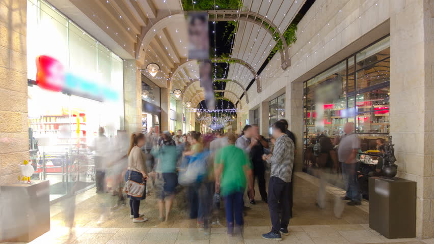 Shoppers and tourists at Mamilla shopping street timelapse hyperlapse in Jerusalem.