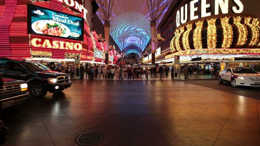 LAS VEGAS CIRCA 2011: Fast motion of traffic and tourists on Fremont Street downtown in Las Vegas, Nevada at night.