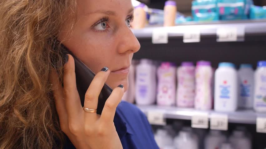 Woman Speaks on Phone During Shopping at Supermarket Store | Shutterstock HD Video #17234680