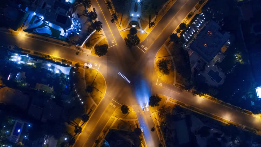 Hyperlapse timelapse of night city traffic on 6-way stop street intersection circle roundabout in Beverly Hills, CA. 4K UHD vertical aerial view. | Shutterstock Video #17248012