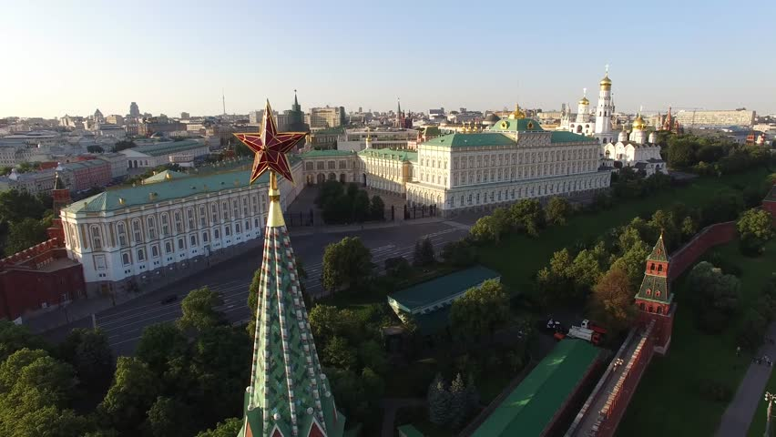 Flight over Moscow Kremlin Star near Red square. City center, downtown. Day road traffic. Unique aerial FPV Drone shot. High altitude. Warm sunset. UltraHD 4K