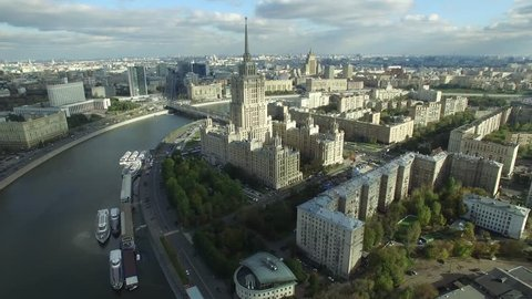 Old Soviet Russia Stalin high-rise skyscrapers in heart of modern Moscow City. Hotel Ukraine from above. Kutuzov avenue day traffic. High altitude Flight.