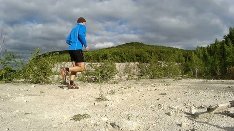 Male runner exercising and training outdoors in nature. traill-running.