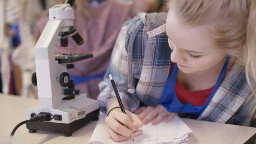 4K Young girl looking through microscope in school science class. Shot on RED Epic. UK - April, 2016 | Shutterstock HD Video #17295160