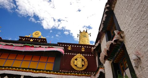 4k closeup of The Jokhang Temple In Lhasa,Tibet,white clouds in blue sky. gh2_09630_4k