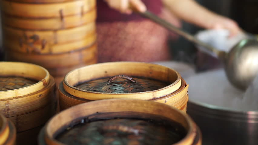 Steaming Dim Sum bamboo trays in different layers traditional Chinese food