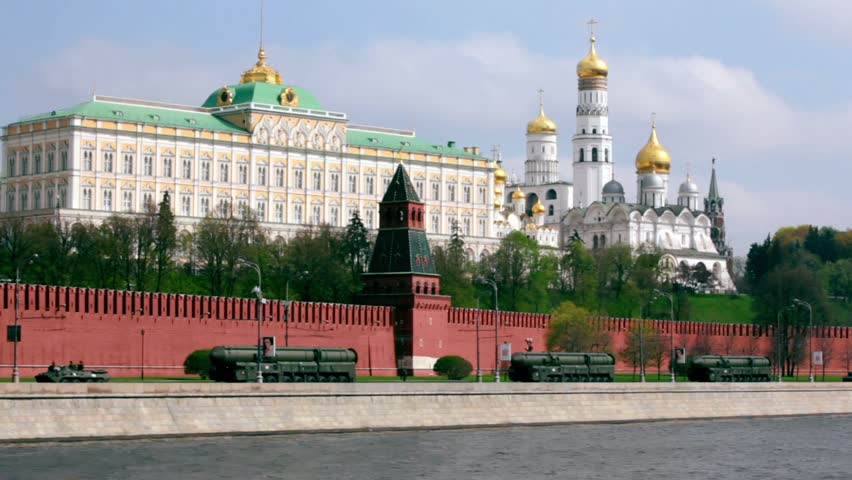 Rockets motorcade ride by quay of Moscow Kremlin, red brick walls and Ivan Great Bell Tower. Victory Day 1945 year. Russia.