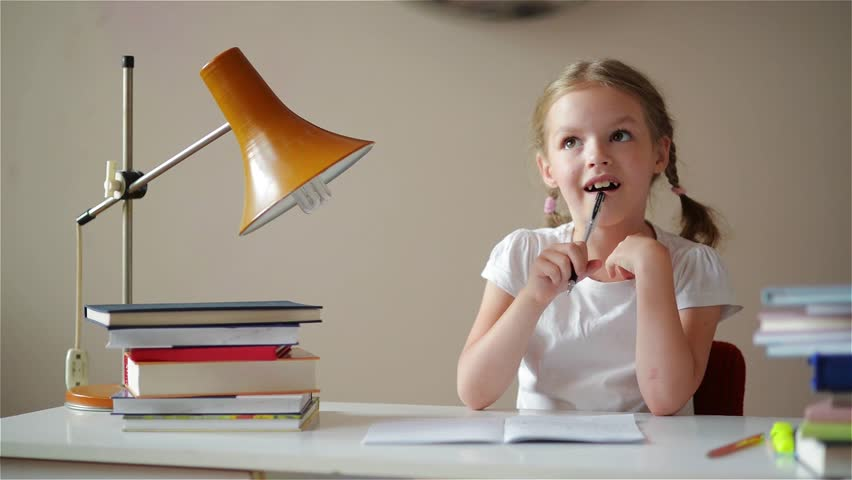 Girl learning lessons, cute girl making her homework, schoolgirl studing at home at the table, children's education, back to school | Shutterstock HD Video #17321170