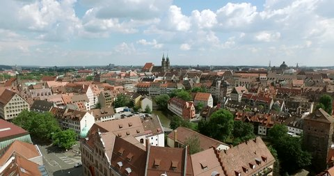 NUREMBERG, GERMANY June 6, 2016: The old city of Nuremberg is filmed in an aerial shot. The camera flies over the river Pregnitz and ends at the church Lorenz.