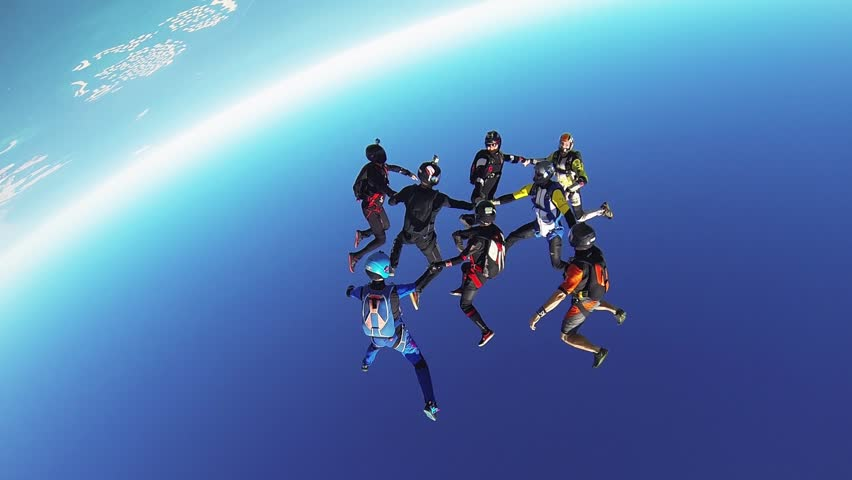 Professional skydivers parachuting above coast of Dubai. Formation. Dance. Sunny day. | Shutterstock HD Video #17377870