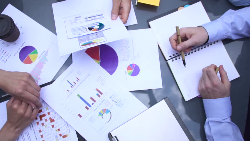 Business chart is placed on the table.   Shutterstock HD Video #17417764