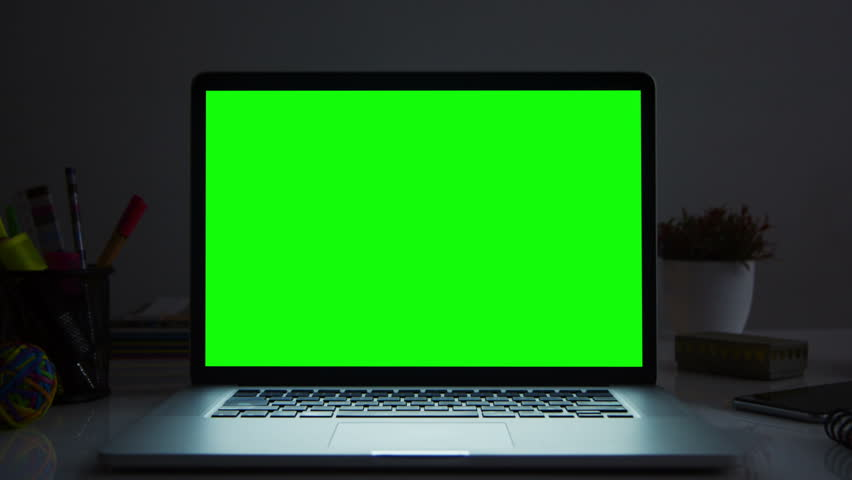 Laptop with green screen. Dark office. Dolly in. Perfect to put your own image or video. Track with perspective corner pin.    | Shutterstock HD Video #17421163