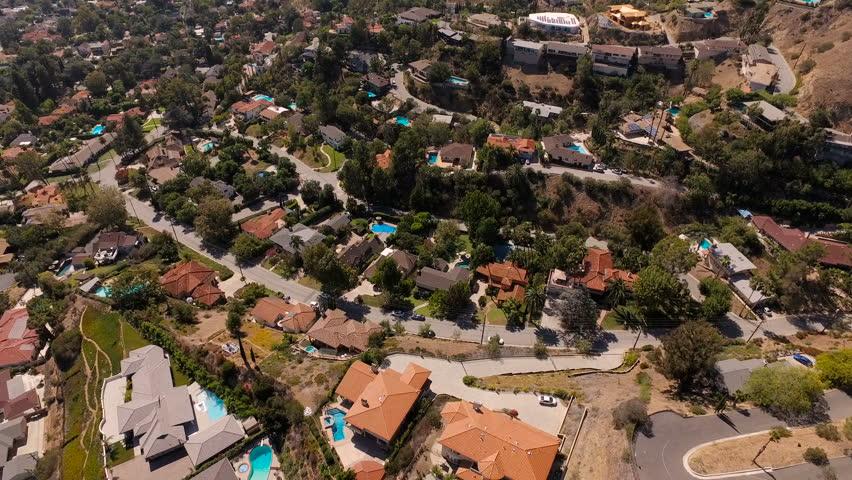 Glendale Aerial v1 Flying over luxury neighborhood in the hills panning down.