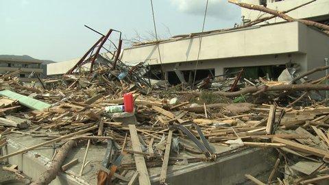 Tsunami Debris Piled Outside Hospital In Japan