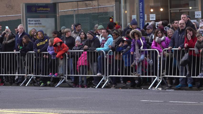 NEW YORK CITY, NY - NOVEMBER 26 : People gathered along fence line waiting for Macy's parade to begin on November 26, 2015 in New York City, New York.