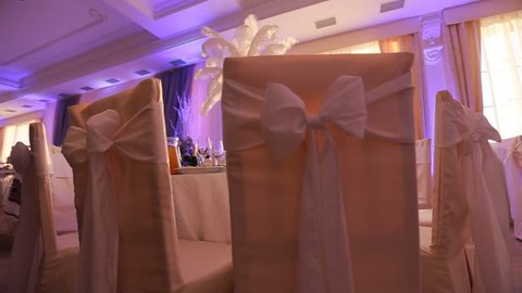 Interior of a wedding hall decoration ready for guests.Beautiful room for ceremonies and weddings.Wedding concept.Luxury stylish wedding reception purple decorations expensive hall.Wedding decor