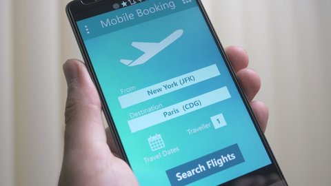 Booking a flight trough a smartphone app.