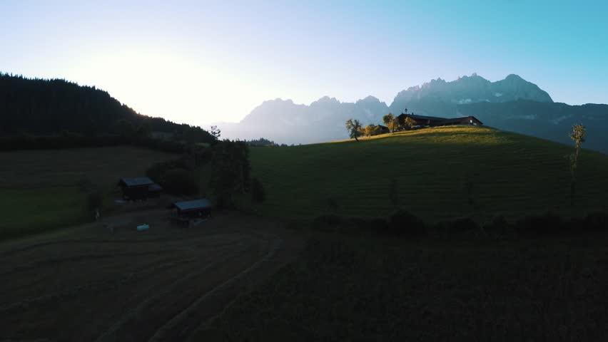 Wilder Kaiser - Farm on a hill at sunset - beautiful austrian landscape #17629390