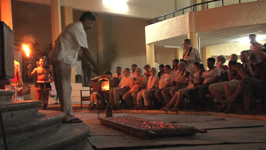 SRI LANKA - CIRCA APRIL 2011: A performer walks barefoot across hot coals circa April 2011 in Sri Lanka.