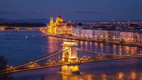 Aerial view of Chain bridge and Parliament building in Budapest, Hungary at night. Time-lapse