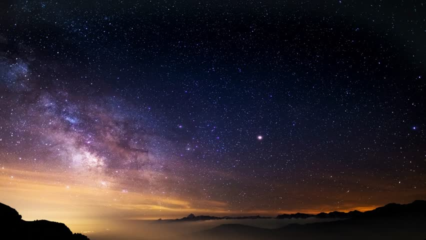 The outstanding beauty of the Milky Way and the starry sky captured at high altitude in summertime on the Italian Alps, Torino Province. Time Lapse 4k video.