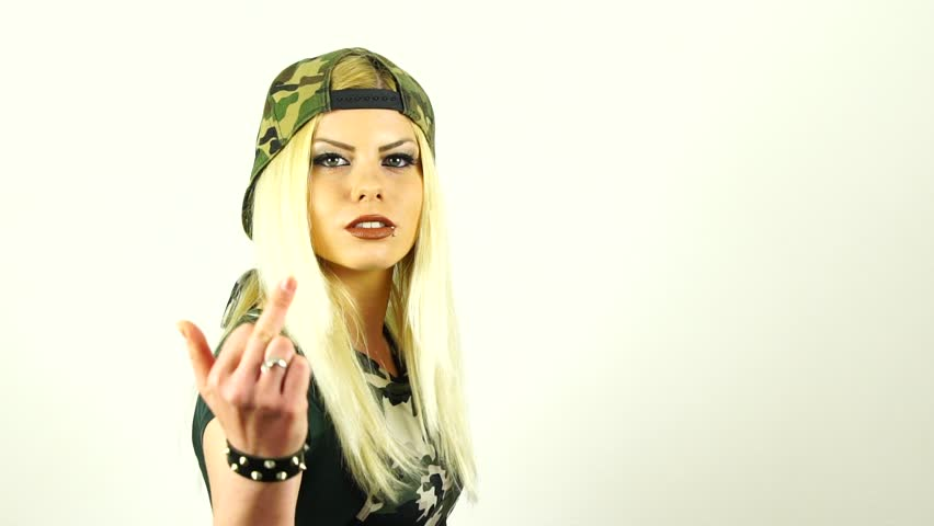 SLOW MOTION: Attractive Caucasian blonde girl is being wild and bad, showing a middle finger gesture to you.
