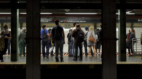 NEW YORK CITY, NEW YORK - JUNE 7: Passengers enter and exit subway train in station on June 7, 2016 in New York City, New York.