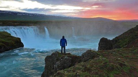 Colorful summer sunset on the Godafoss Waterfall on  Skjalfandafljot river. Iceland, Europe. Full HD video (High Definition).