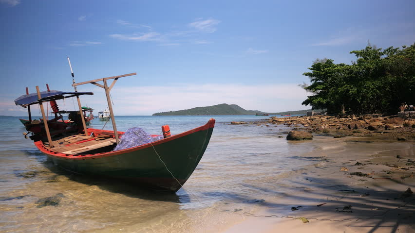 Small traditional fishing boat tied at the beach under clear blue sky ( close up )  #17752780