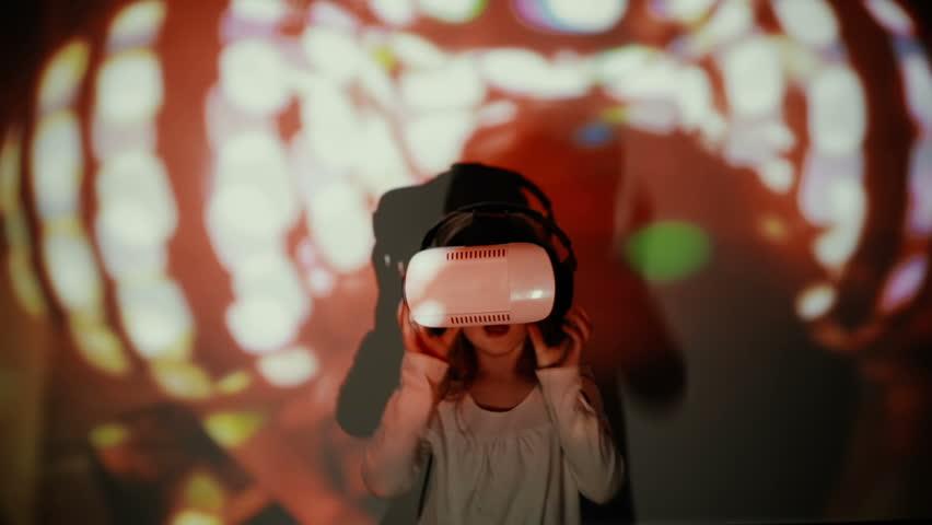 Little girl using VR-helmet. vr dance simulator