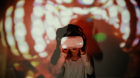 Little girl using VR-helmet. vr dance simulator
