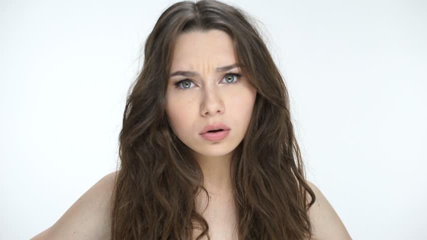 Young beautiful girl knocking at camera
