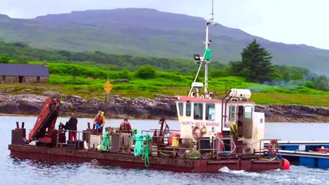 June 29th 2016. Ulva, Isle of Mull, Scotland, UK. Workmen working on the new floating platoon at the Vulva ferry, Isle of Mull, Scotland, Uk