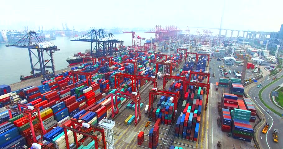 HONG KONG, CHINA - APRIL 1, 2016: Flying high above a lot of cargo containers in port of Hong Kong and trucks driving between them. Aerial. | Shutterstock HD Video #17814490
