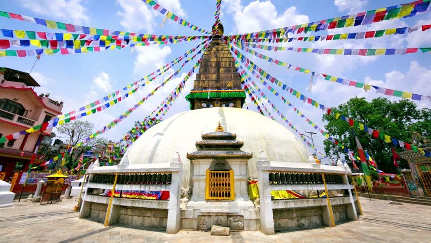 4k timelapse. Chabahil Stupa with Buddha wisdom eyes and prayer colorful flags. Chabahil Stupa is the fourth largest in the Kathmandu area after Bodhnath, Swayambhunath and the Kathesimbhu Stupa.