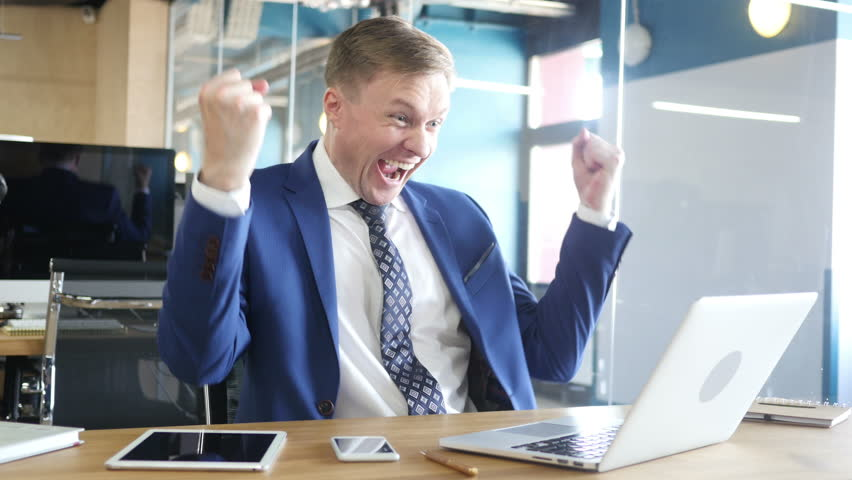 Excited businessman celebrating success