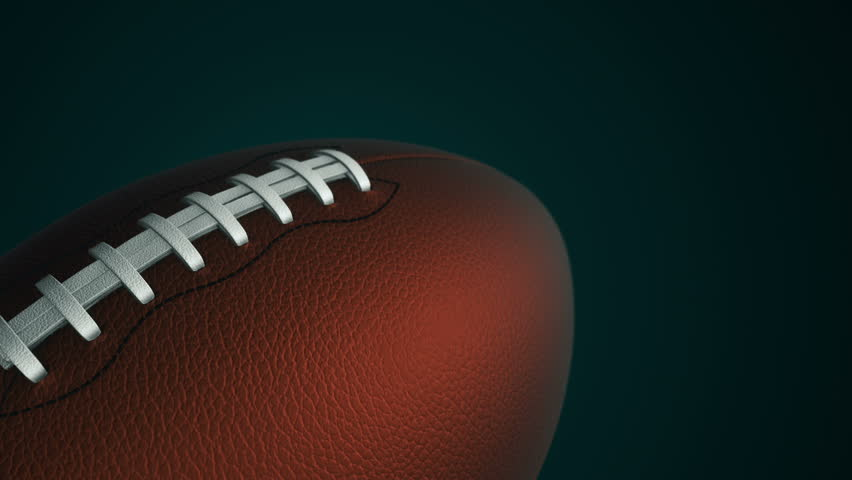 Animation of slow rotation ball for american football. View of close-up with realistic texture and light. Animation of seamless loop. | Shutterstock HD Video #17885620