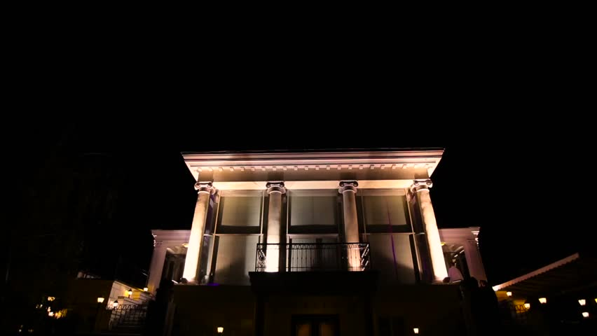 Big house with column lighting at the night.