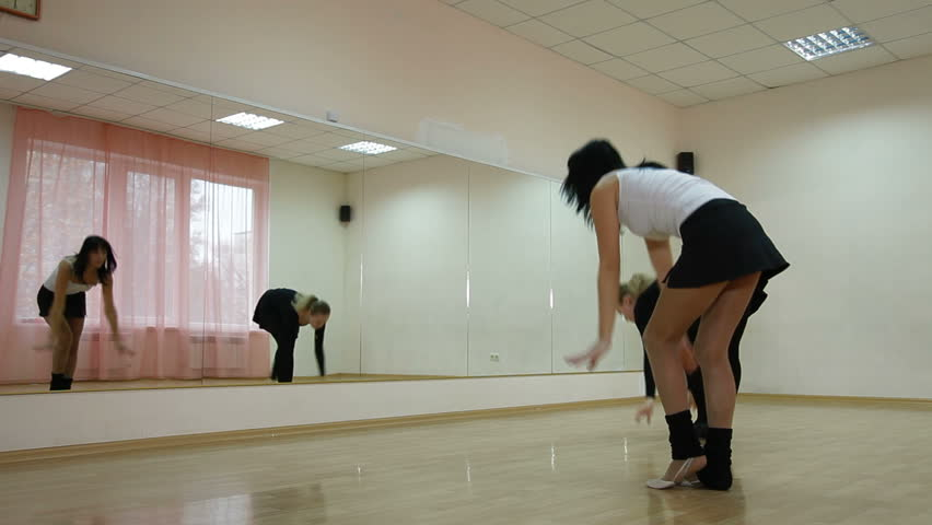 Woman exercising with personal trainer in the ballroom | Shutterstock HD Video #1790330