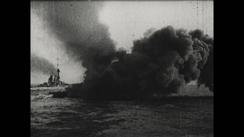 ESTONIA 1917: Guns on Ship Point Out towards Sea. Ships Guns Being Fired. Smoke Around Ship. Two Ships in Parallel as One Fires Guns.