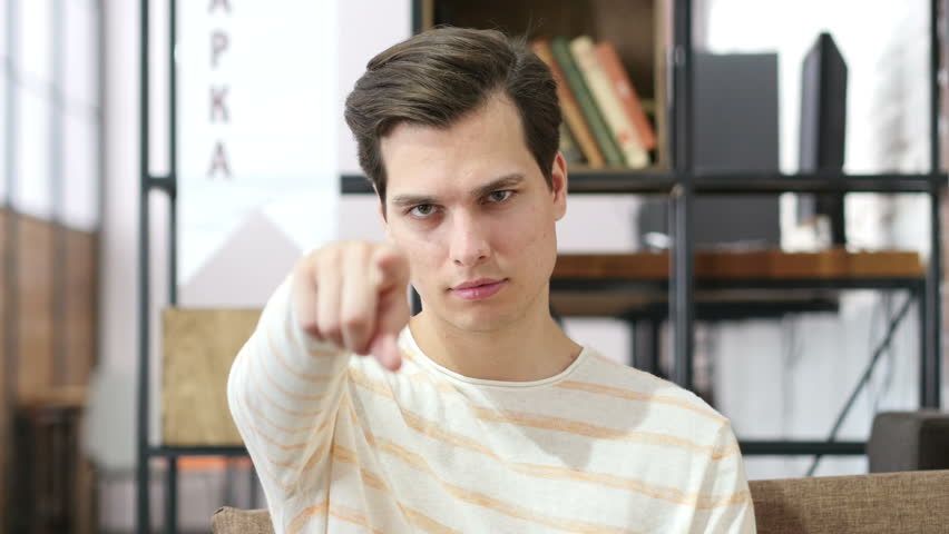 Young man points his finger at you , selection | Shutterstock HD Video #17914690