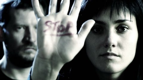 Concept of stop to violence on women with woman and man closeup